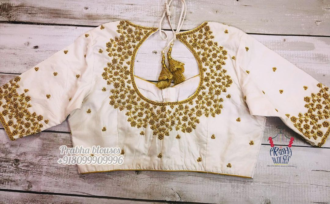 Stunning off white color blouse with gold bead and thread maggam work. Blouse with pot hole. 2021-04-30