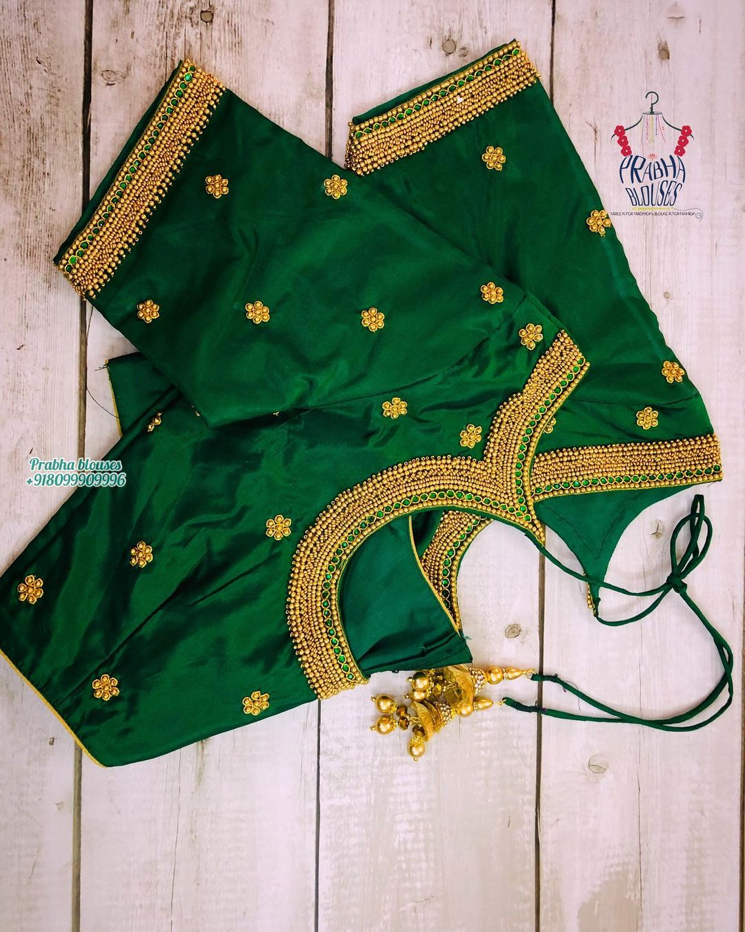 Lovely leaf green color blouse with floral buti design hand embroidery bead and gold thread maggam work.  2021-04-30