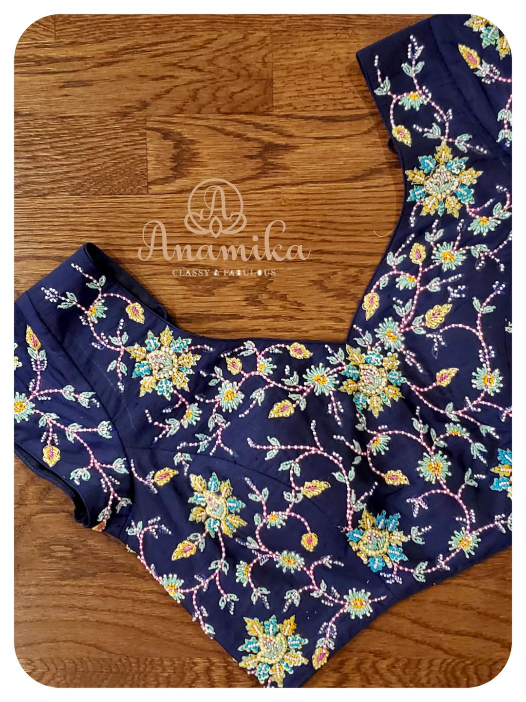Navy blue color blouse with floral and creeper design hand embroidery thread and bead aari work.  2021-05-01