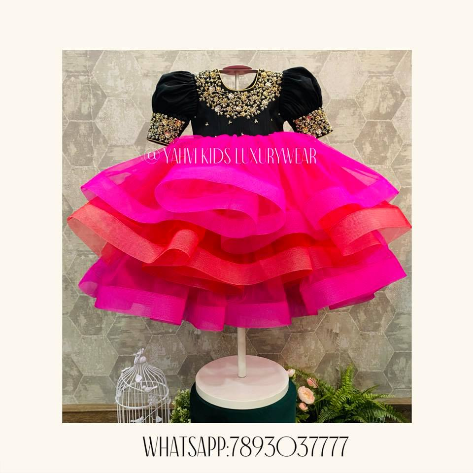 Gorgeous pink and black colour combination kids ruffle frock wth hand embroidery work on neckline.  2021-05-02