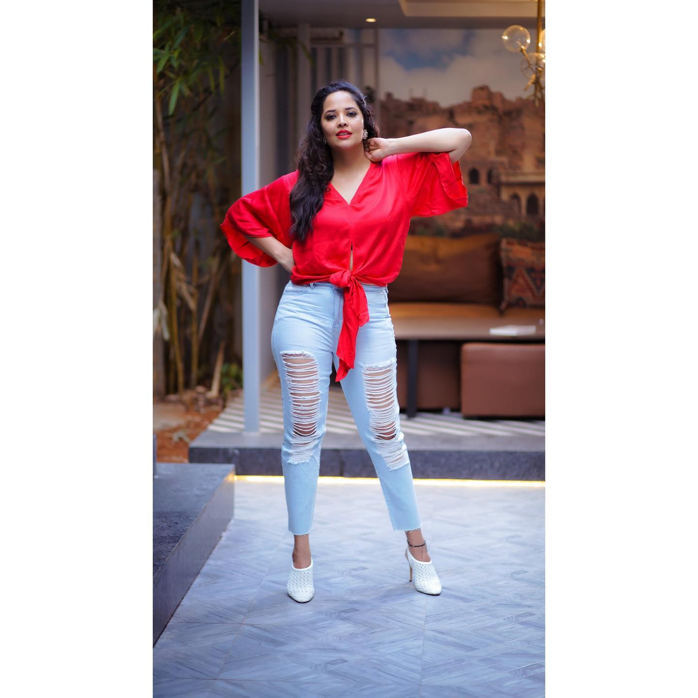 Beautiful actress Anasuya Bardwaj in denim distressed jeans and red shirt. 2021-05-02