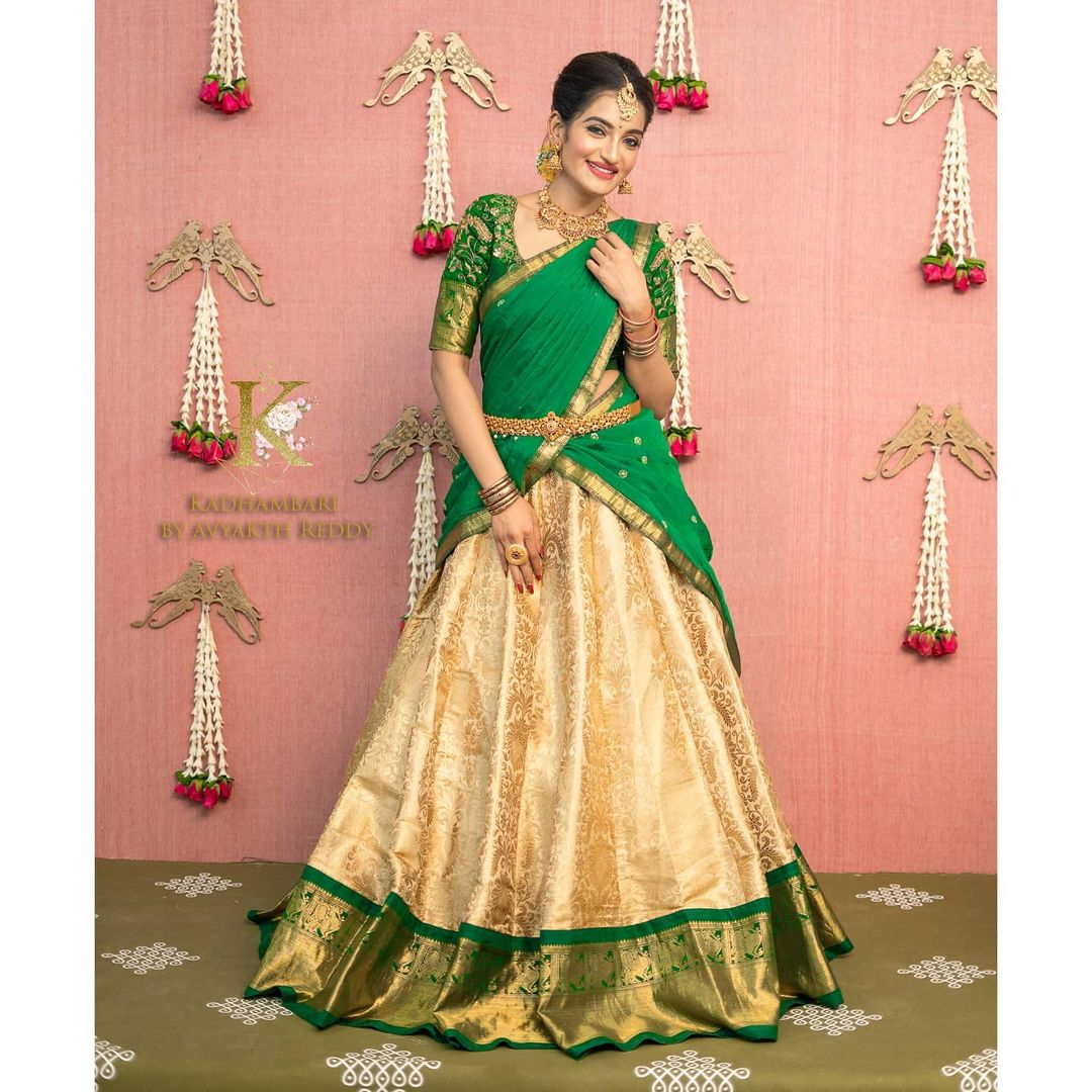 Gorgeous off white and green color combination pattu langa voni.  Pretty colours and intricate deamrmtails for the pretty you. 2021-05-02