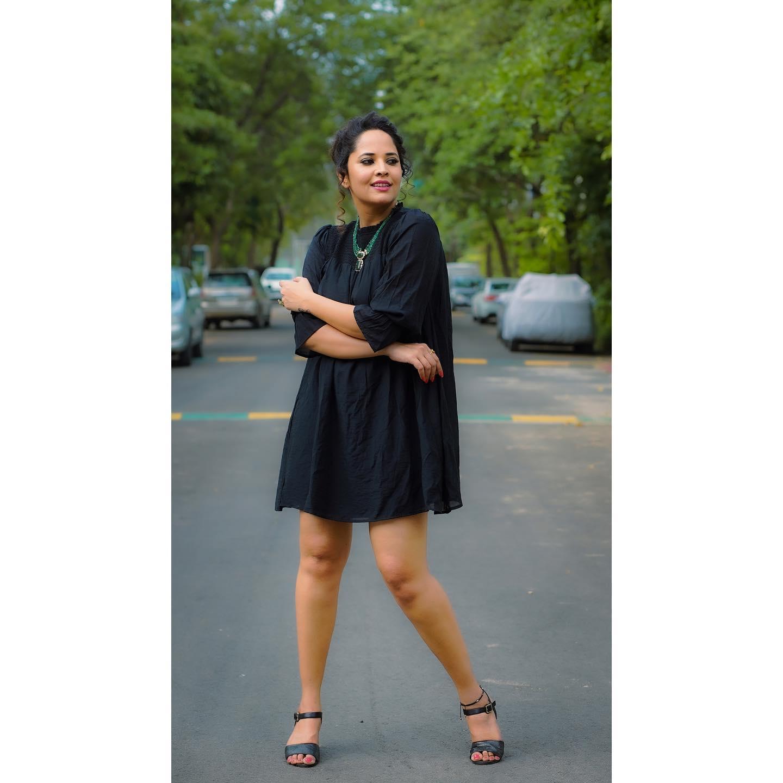 Beautiful actress Anasuya Bardwaj in black knee length shirt dress. 2021-05-03