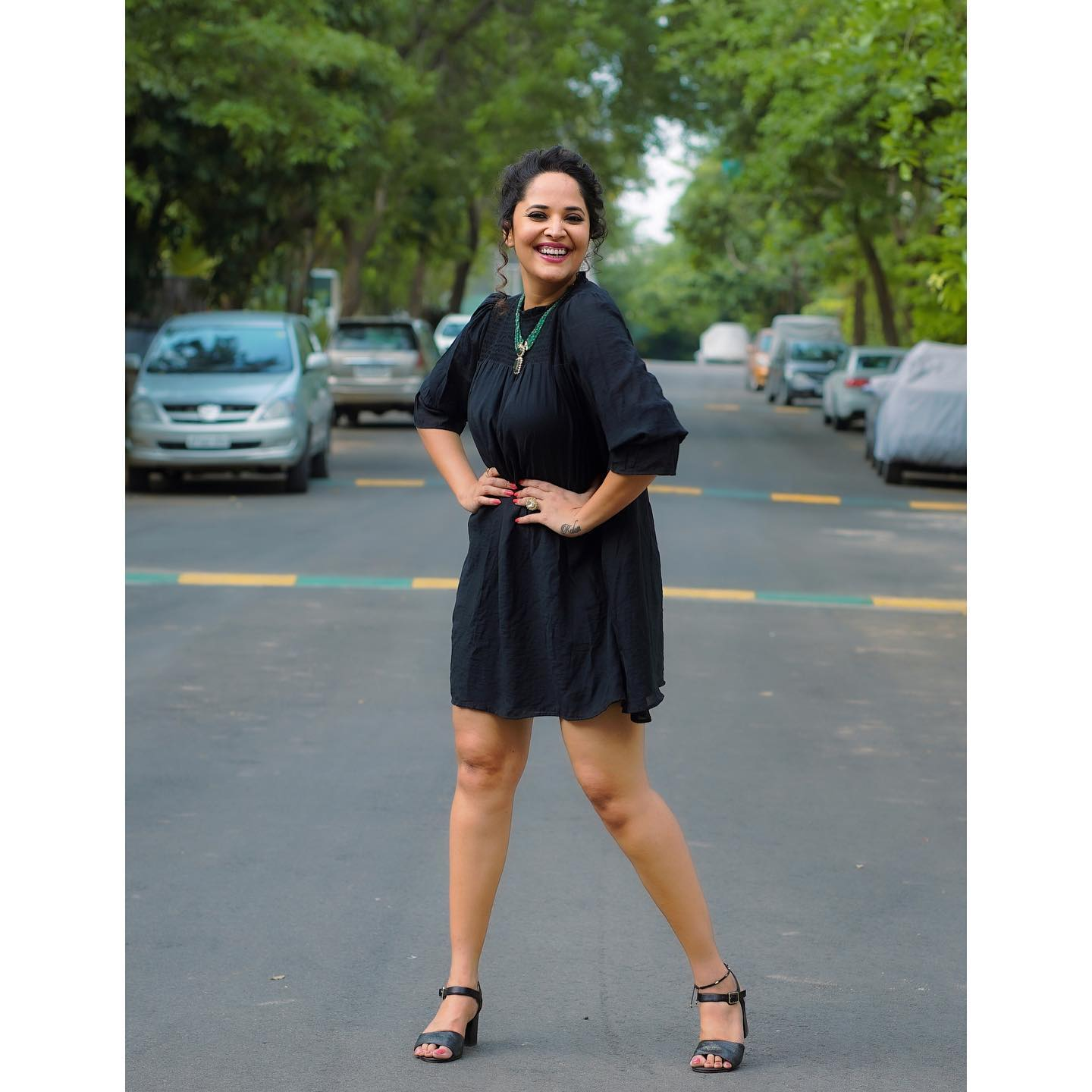 Beautiful actress Anasuya Bardwaj in black knee length shirt dress. 2021-05-03