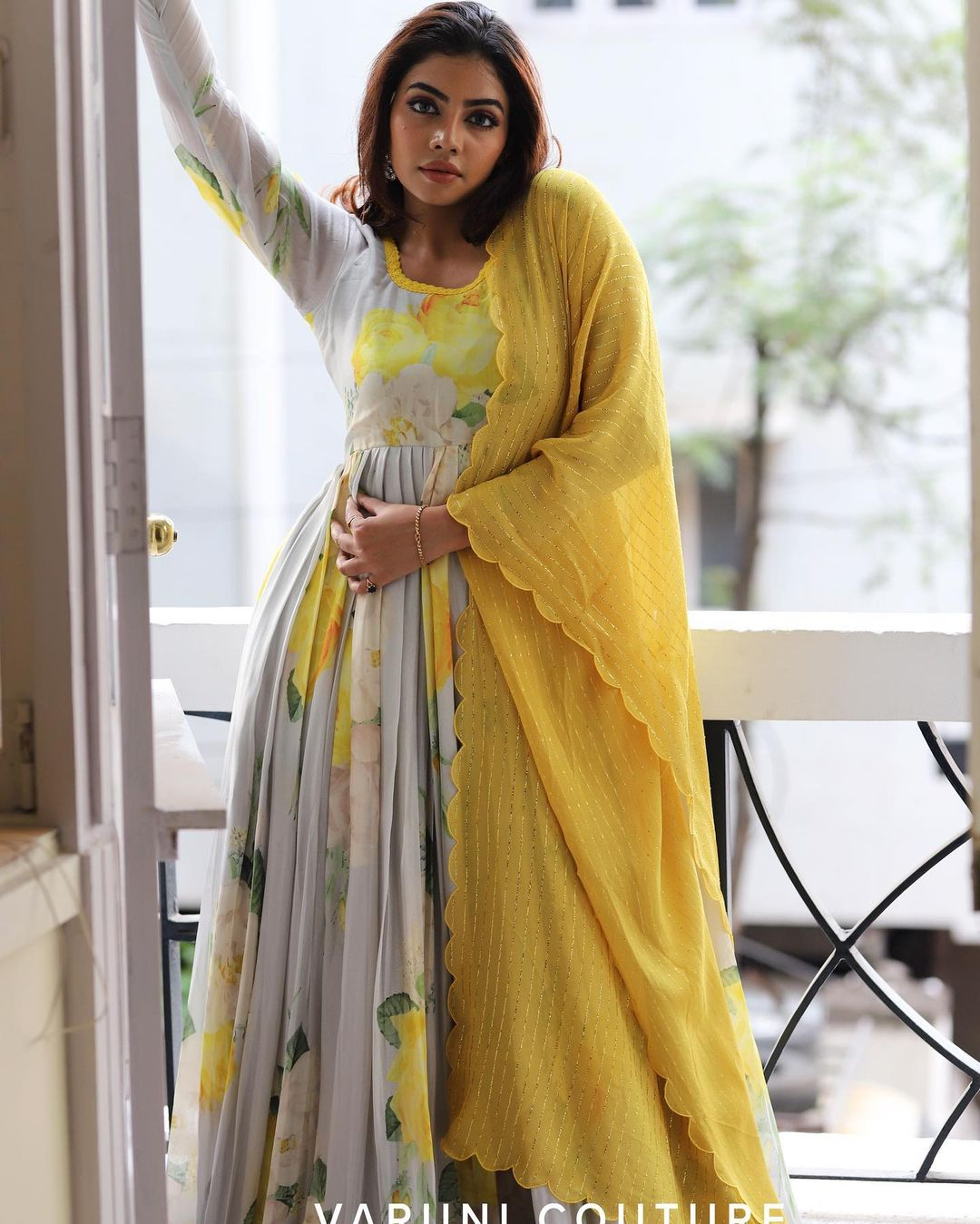 Stunning gray colour floral annarkali dress with yellow net dupatta. Outfit priced at 8200 INR.