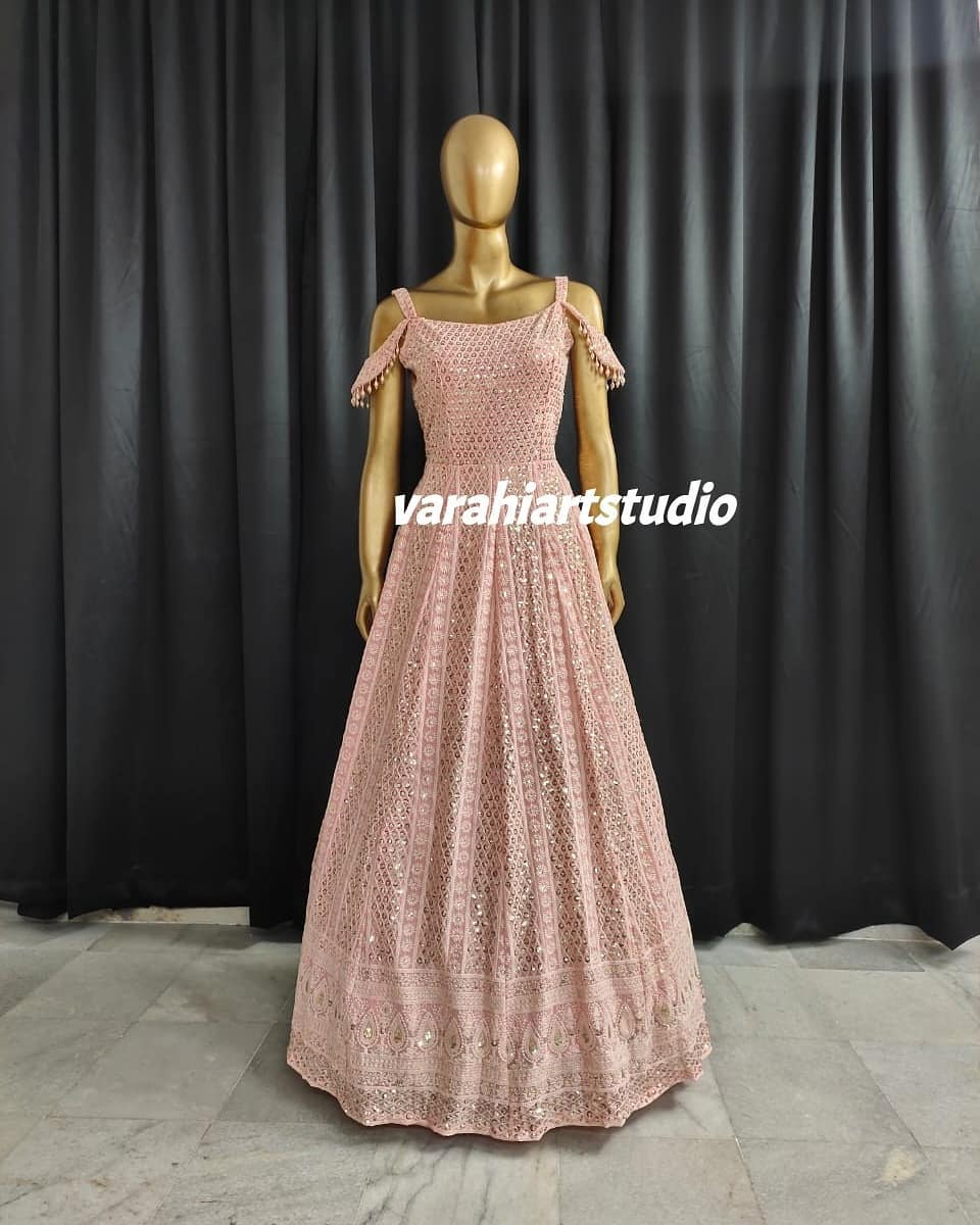 Stunning cold shoulder floor length dress with mirror work.