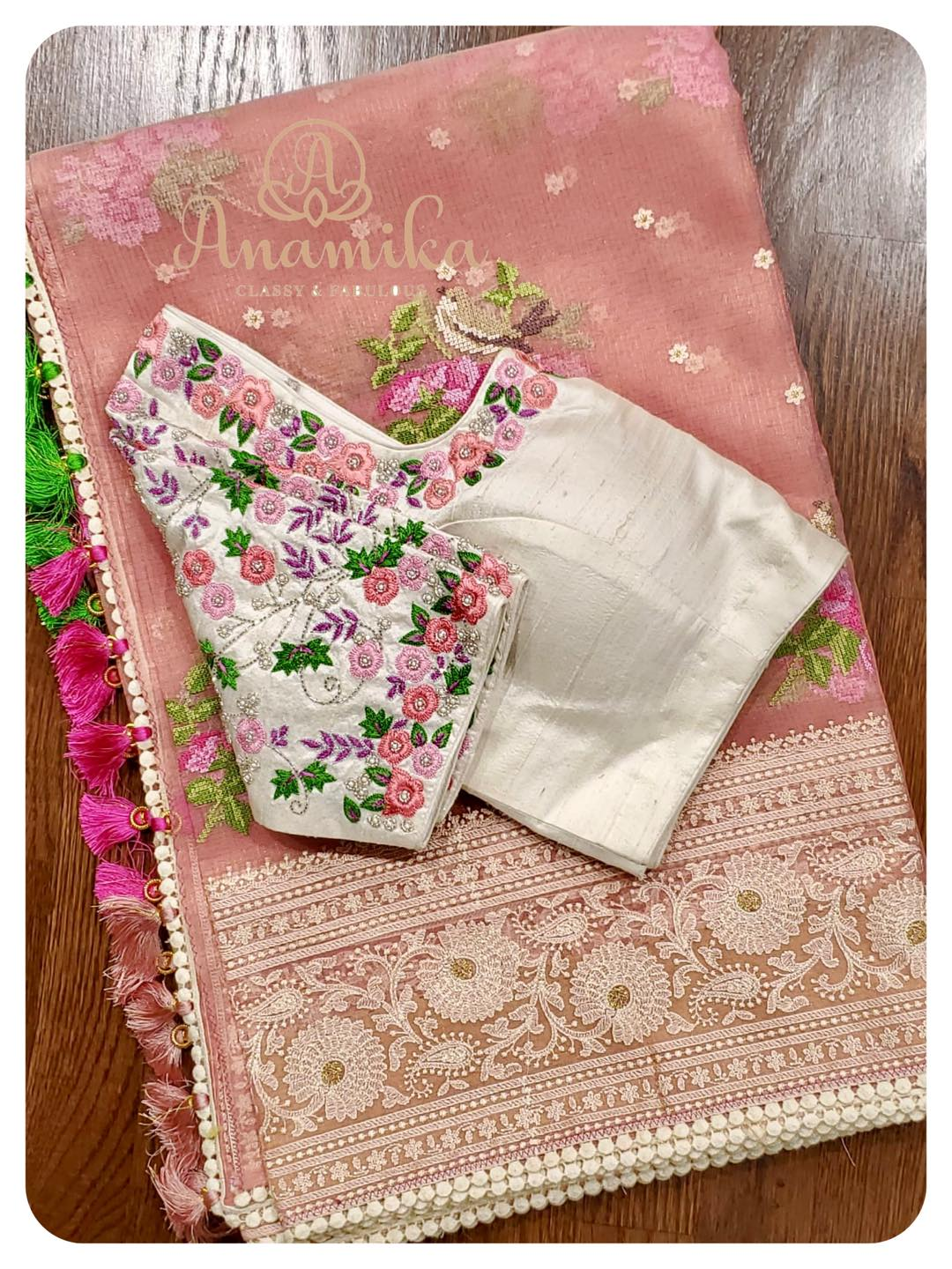 Pretty in Pink and Pastel ! Handwoven on Kota tissue sare this peach pink saree with chikankari border and cross stitch buttis – is just so pleasant and pleasing! So new and fresh you will rock and roll in this.  Paired with  off white blouse with intricately designed handwork is a treat for sure. A royal designer piece that makes you stand out in your next party! DM 360-545-3636 for inquiries. 2021-05-04