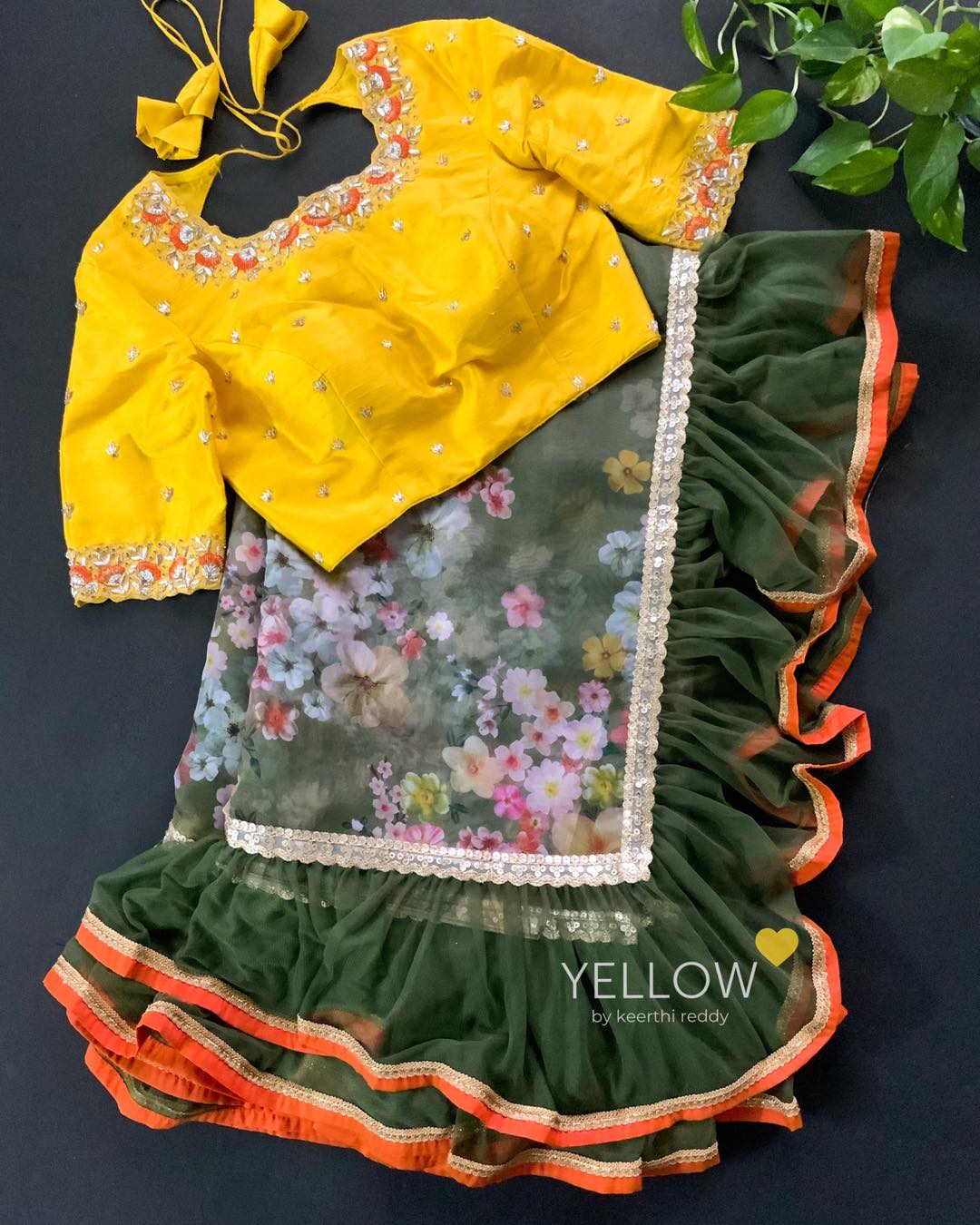 Customised Family coordinated outfits in Yellow and orange highlights . 