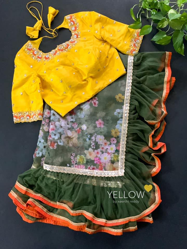 Stunning green colour floral ruffle saree with yellow color hand embroidery blouse.  2021-05-04