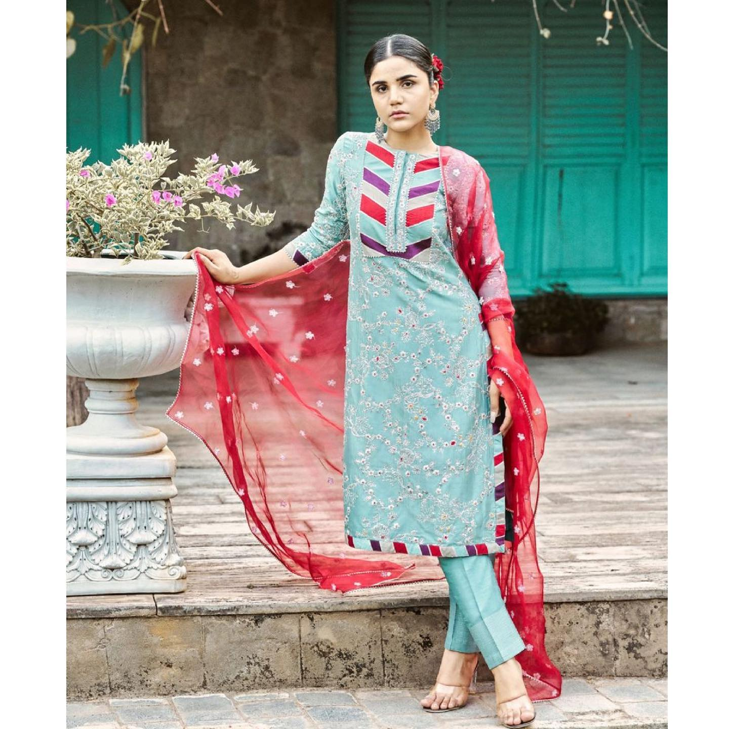 Phulwari . Seen here on Harshita is skyline blue kurta set with patchwork detailing on the yoke and pita floral creepers all over the kurta. It's contrast berry red dupatta brings in lots of vibrancy perfect for summer weddings.  To shop our new collection Phulwari DM  or Whatsapp  on +91 6302 878 533 2021-05-04