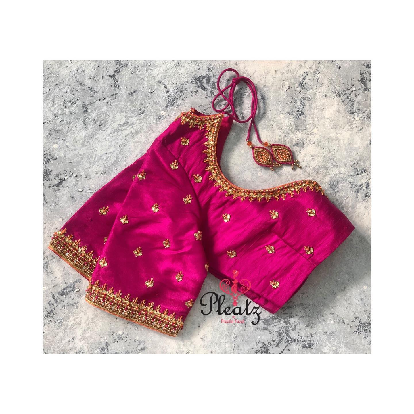 Stunning pink color blouse with simple zardosi work. Handcrafted elegant blouses only at Pleatz. Classy designs to attend wedding parties & for other Occasions. 2021-05-04