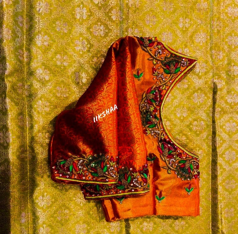 Stunning orange color brocade blouse with floral creeper design hand embroidery  thread and stone aari woork. 2021-05-04