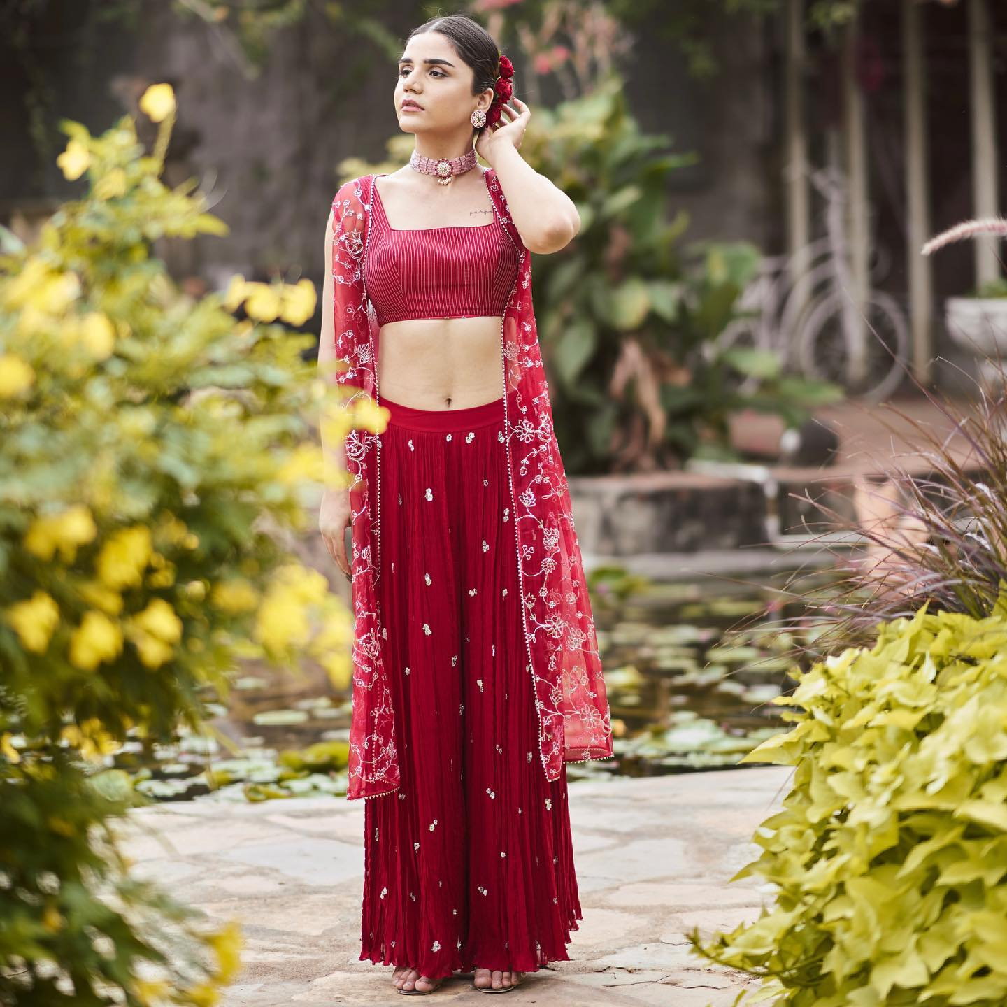 Phulwari . Harshita seen in Berry Red crushed sequin butti pants with a minimal blouse and stunning all over pita embroidered cape.  To shop our new collection Phulwari  DM us or Whatsapp us on +91 6302 878 533 2021-05-05