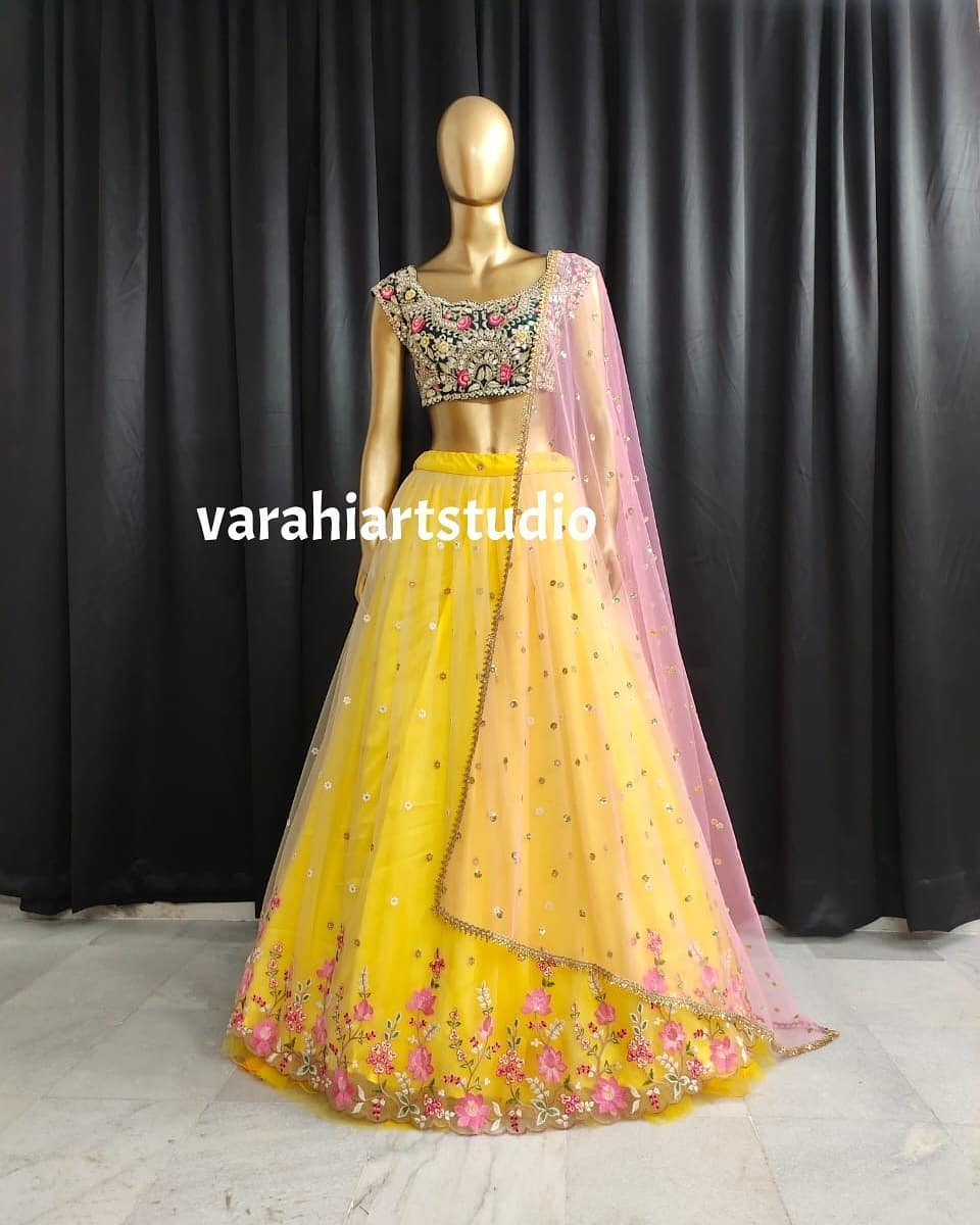 Stunning yellow color floral bridal lehenga and blouse with net dupatta.