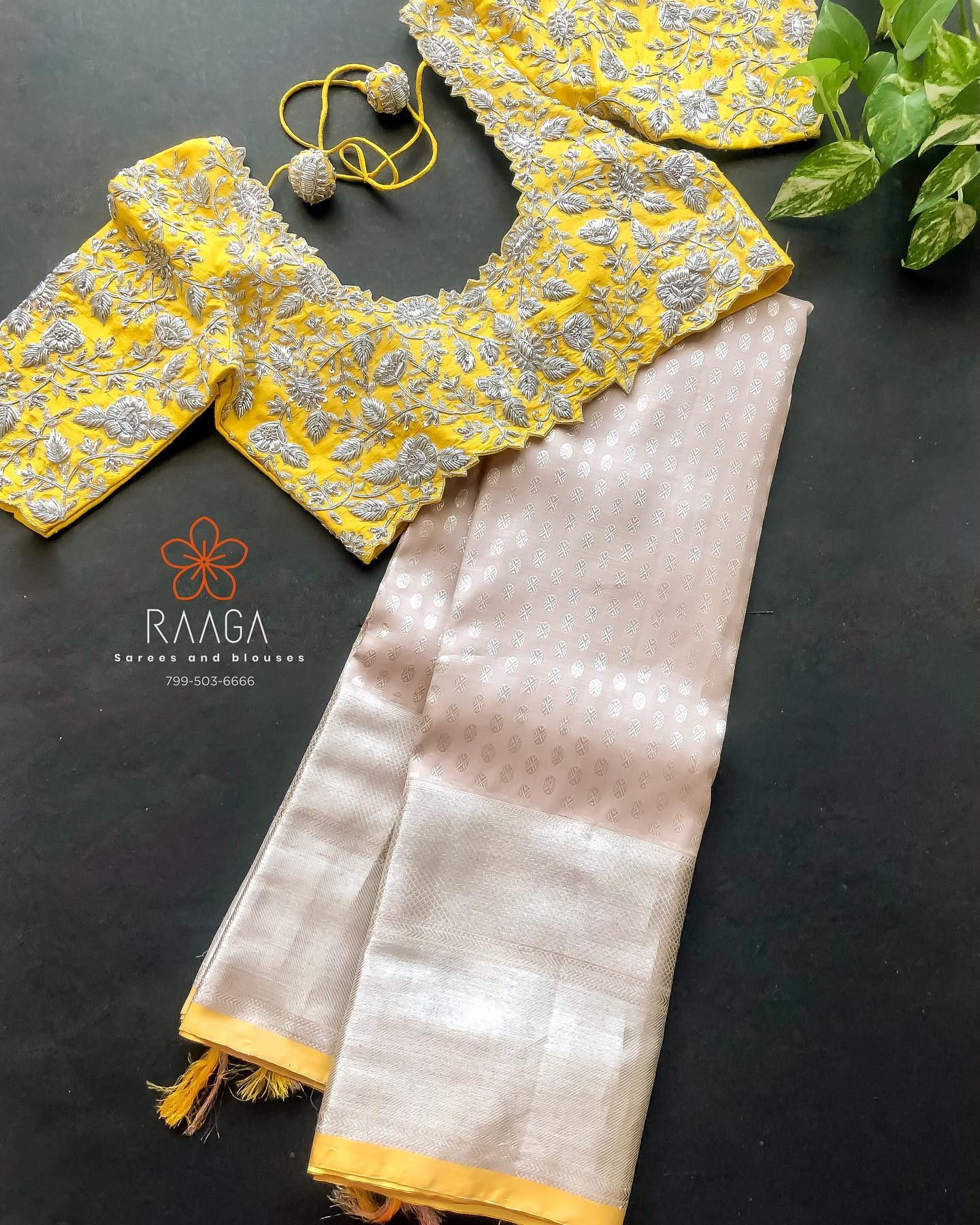 Custom made hand worked blouses paired up with pure silk sarees for upcoming wedding season . Stunning yellow colour blouse design with floral hand embroidery silver thread maggam work. Maggam work blouse for pattu sarees.  2021-05-06