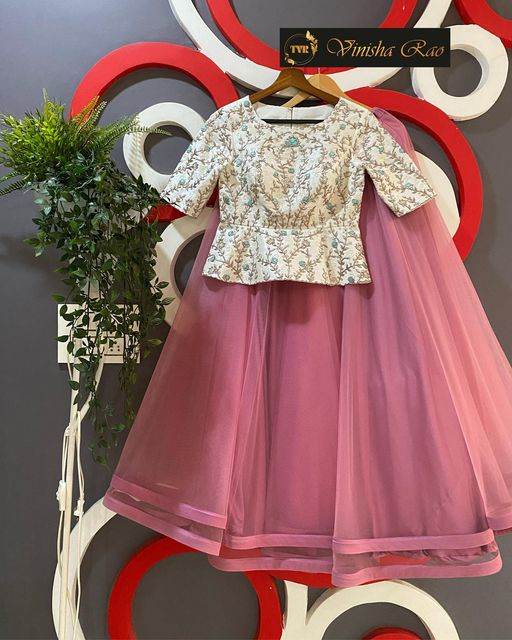 Lovely french pink tulle double layered lehenga teamed up with glass beads  sequence and pearls hand embroidered white bridal blouse from the house of Vinisha rao designer studio !! Suitable for all kind of occasions !!
