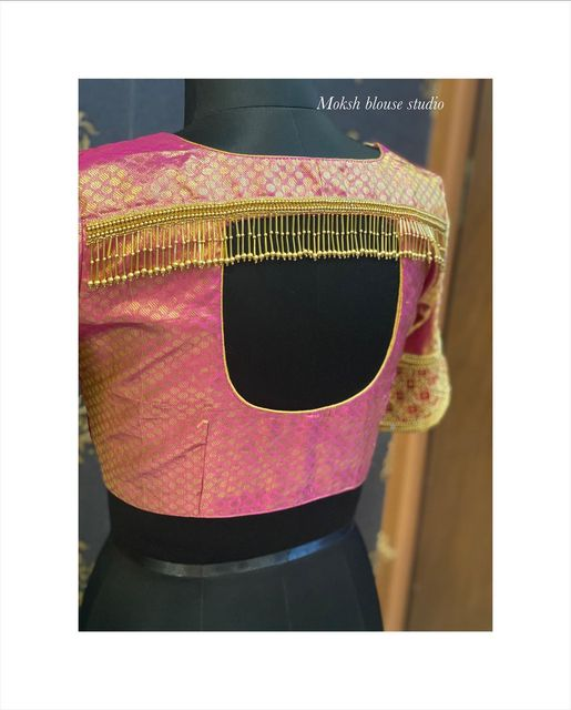 Stunning pink colour brocade blouse back design with bead tassels hangings. Brocade blouse with bead aari work.  2021-05-06