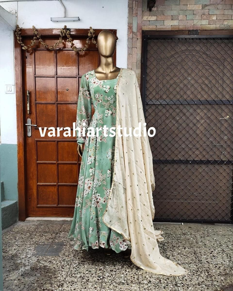 This floral Anarkali is Available from Varahi art studio ..