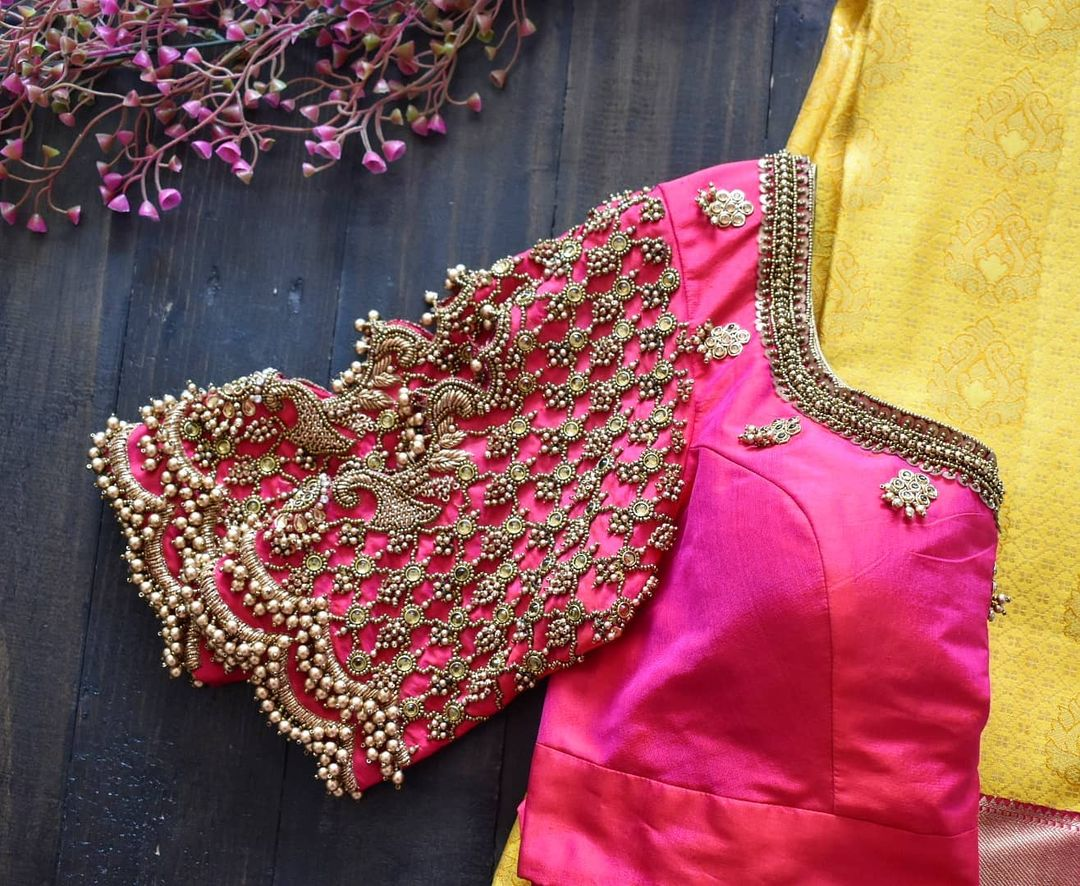 Closely embroidered pearl hanging Paisley cutwork at the centre all stitched on pure silk blouse sleeve. 2021-05-06