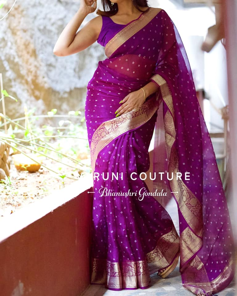 Stunning purple colour Bandhej Organza saree. 