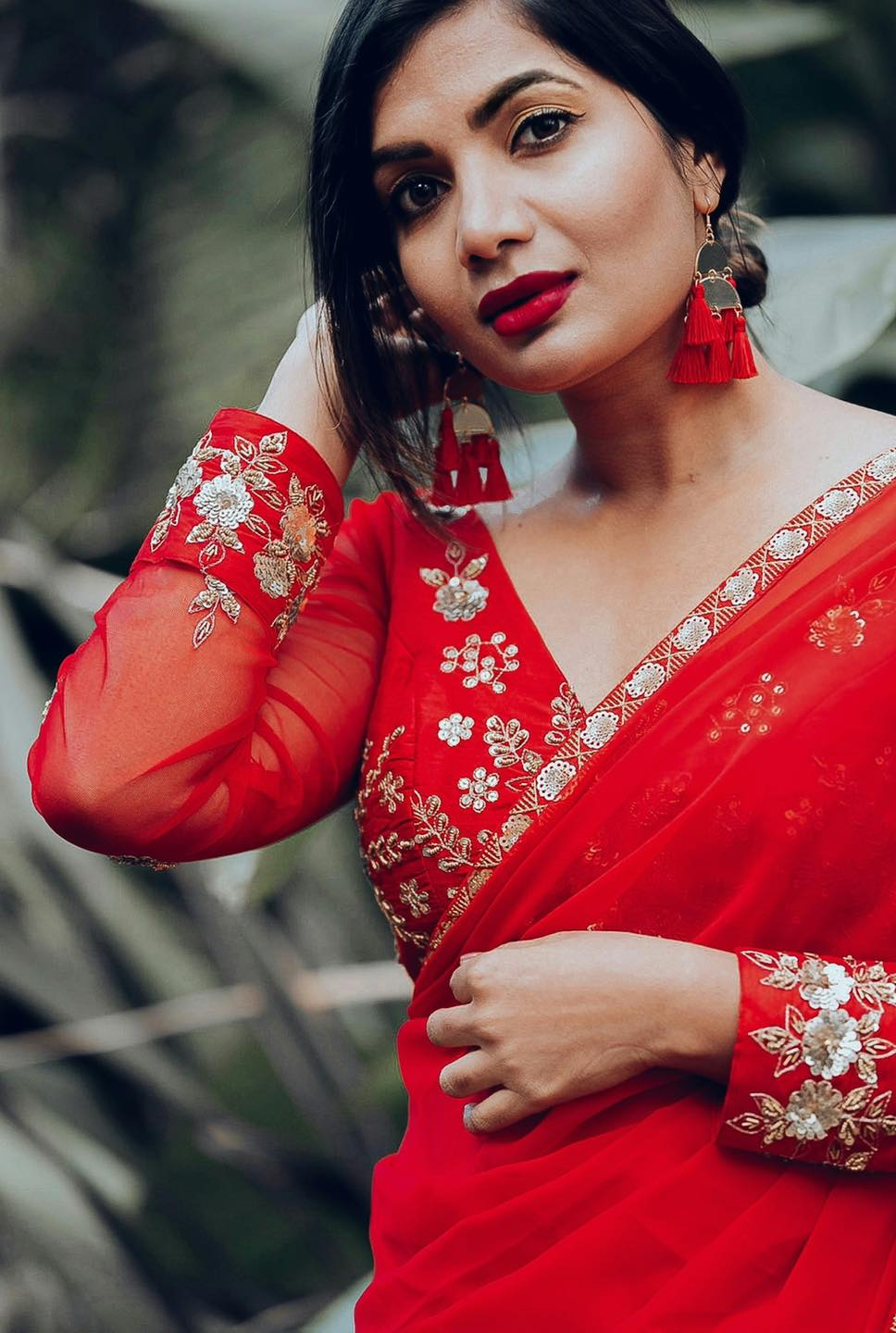 Gorgeous red georgette sari with a sequin worked border and glass bead tassels at the edge of the pallu! The blouse is silk hand embroidered in zardozi and sequin work! 2021-05-07