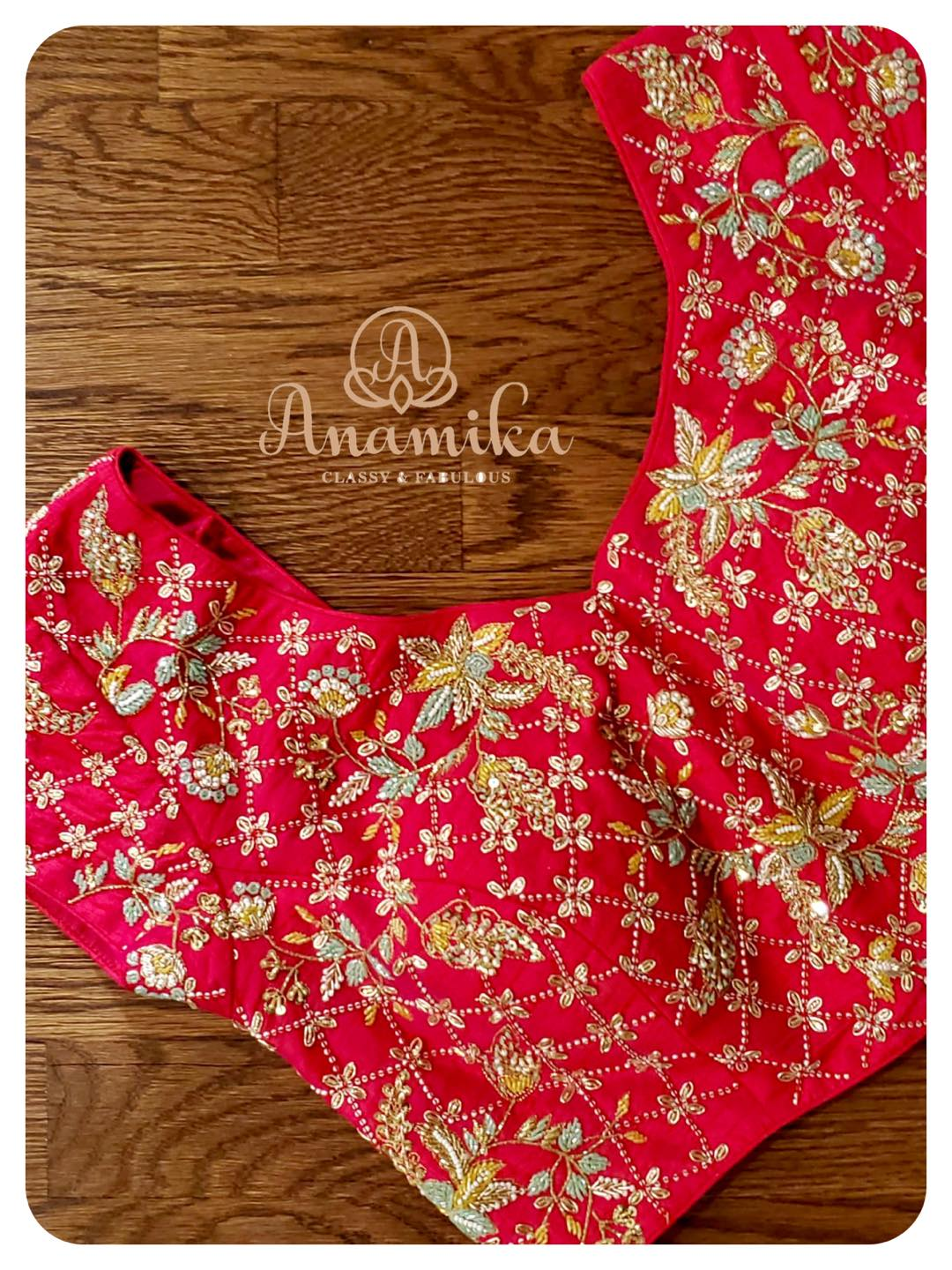 Stunning tomato pink color heavy work blouse with  hand embroidery sequins zardozi and cutdana work. 2021-05-07