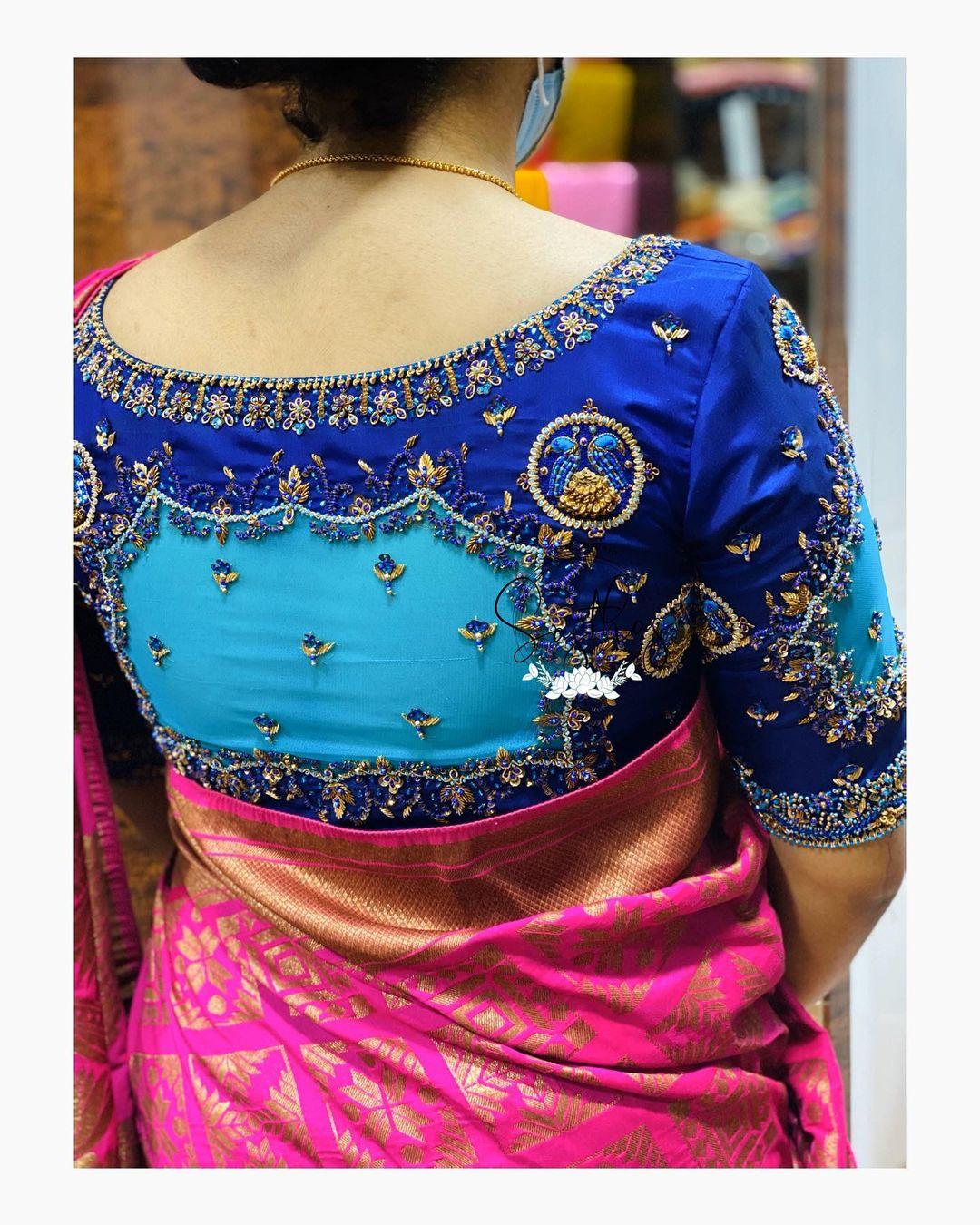 Stunning blue color blouse sleeve design with floral zardosi work.  2021-05-07