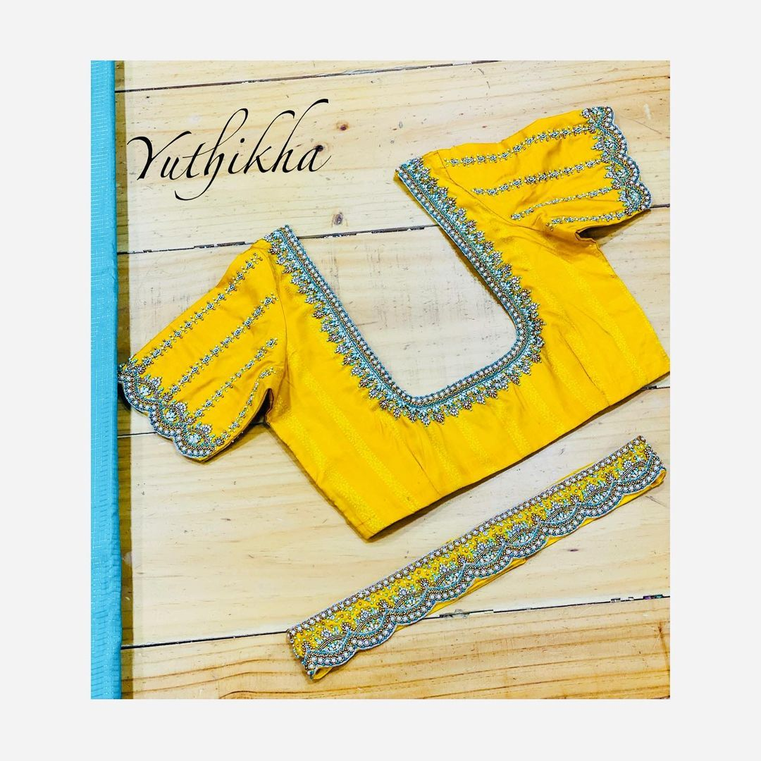Customised embroidery blouse cum waistbelt from the house of yuthikha designer studio !!! For appointments contact 9894231384 2021-05-07