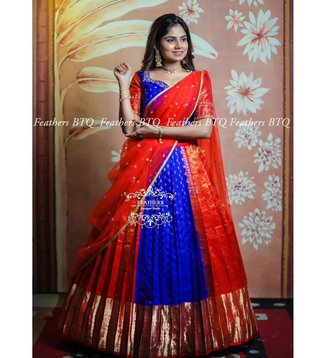 Beautiful orange and blue color combination pattu langa voni. Exclusive Bridal lehangas