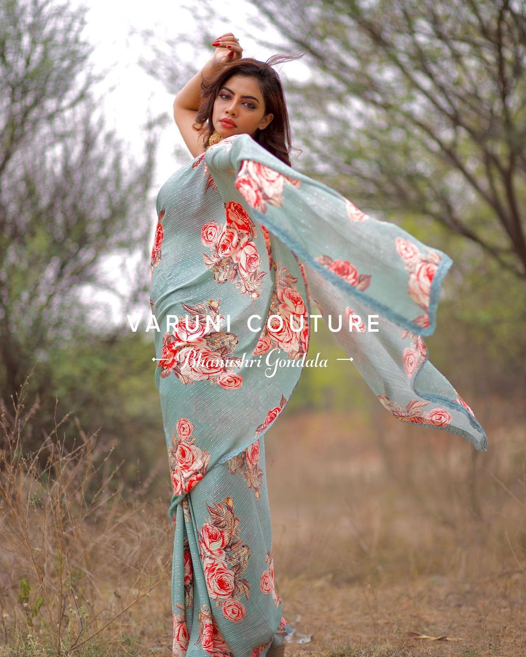 Stunning ice blue color floral saree and red color sleeveless blouse. Price 6999 INR  For sales / orders WhatsApp 9121017226 Email varunicouturehyd@gmail.com 2021-05-09