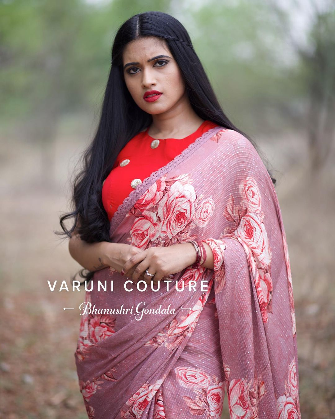 Stunning lavender  color floral saree and red color sleeveless blouse. Price 6999 INR
