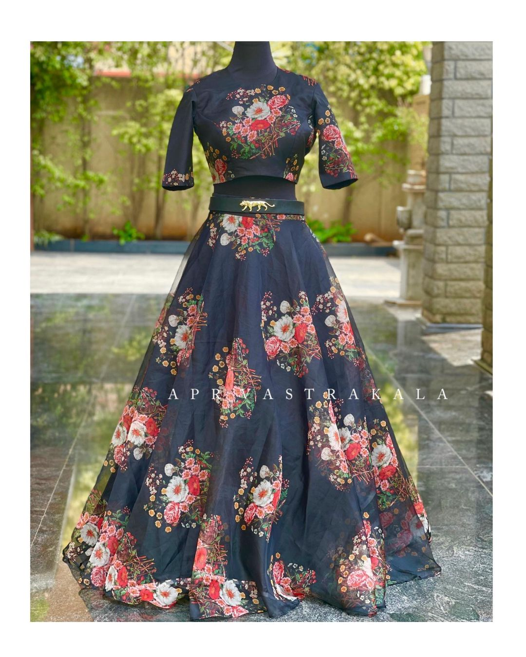 Sabyasachi inspired design Printed organza floral crop top and skirt paired with leather belt. 2021-05-09