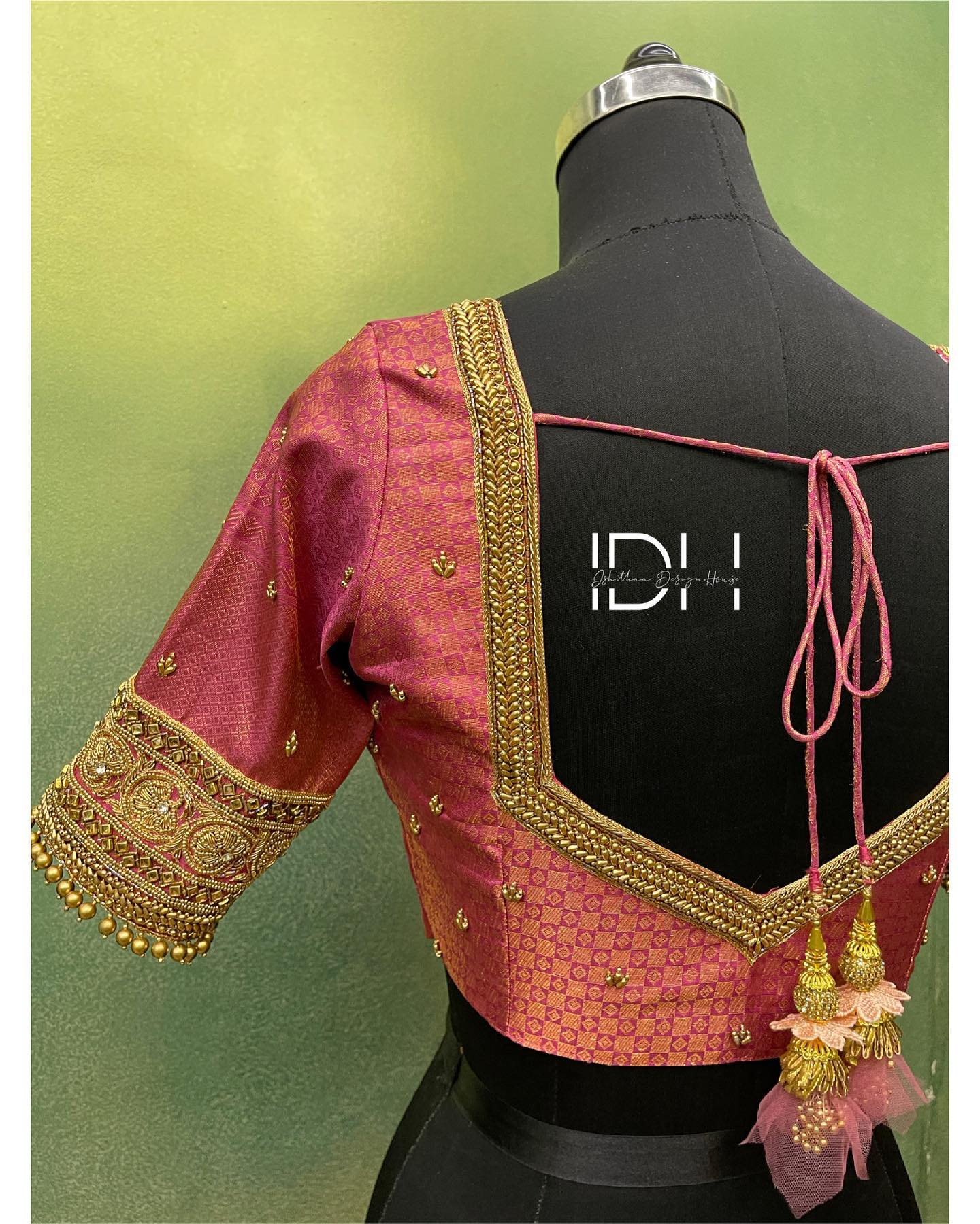 Stunning pink brocade blouse design with bead and gold thread aari work on neckline and sleeves. Blouse with fabric flower tassels.  2021-05-10