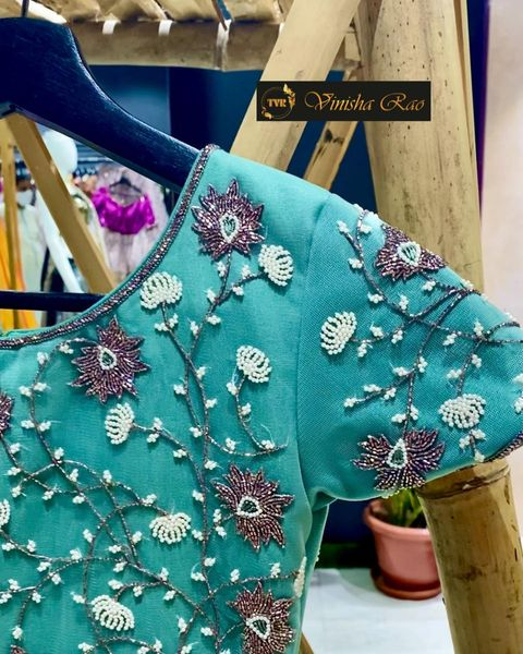 A refreshing and soothing pastel mint green long dress which gives you a fresh look when you add up little things like coral coloured handbag and footwear. This dress is teamed up with glass beads hand embroidery work on front and back of the yoke exclusively from the house of Vinisha rao designer studio !! Suitable for all kind of occasions !! 
