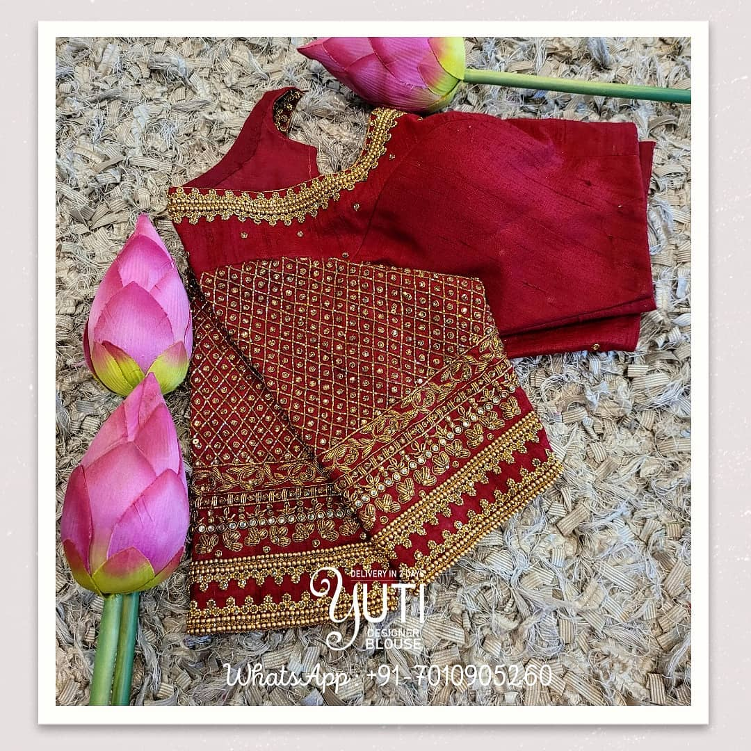 Stunning maroon color bridal blouse design with gold thread and stone aari work on neckline and sleeves. 2021-05-11