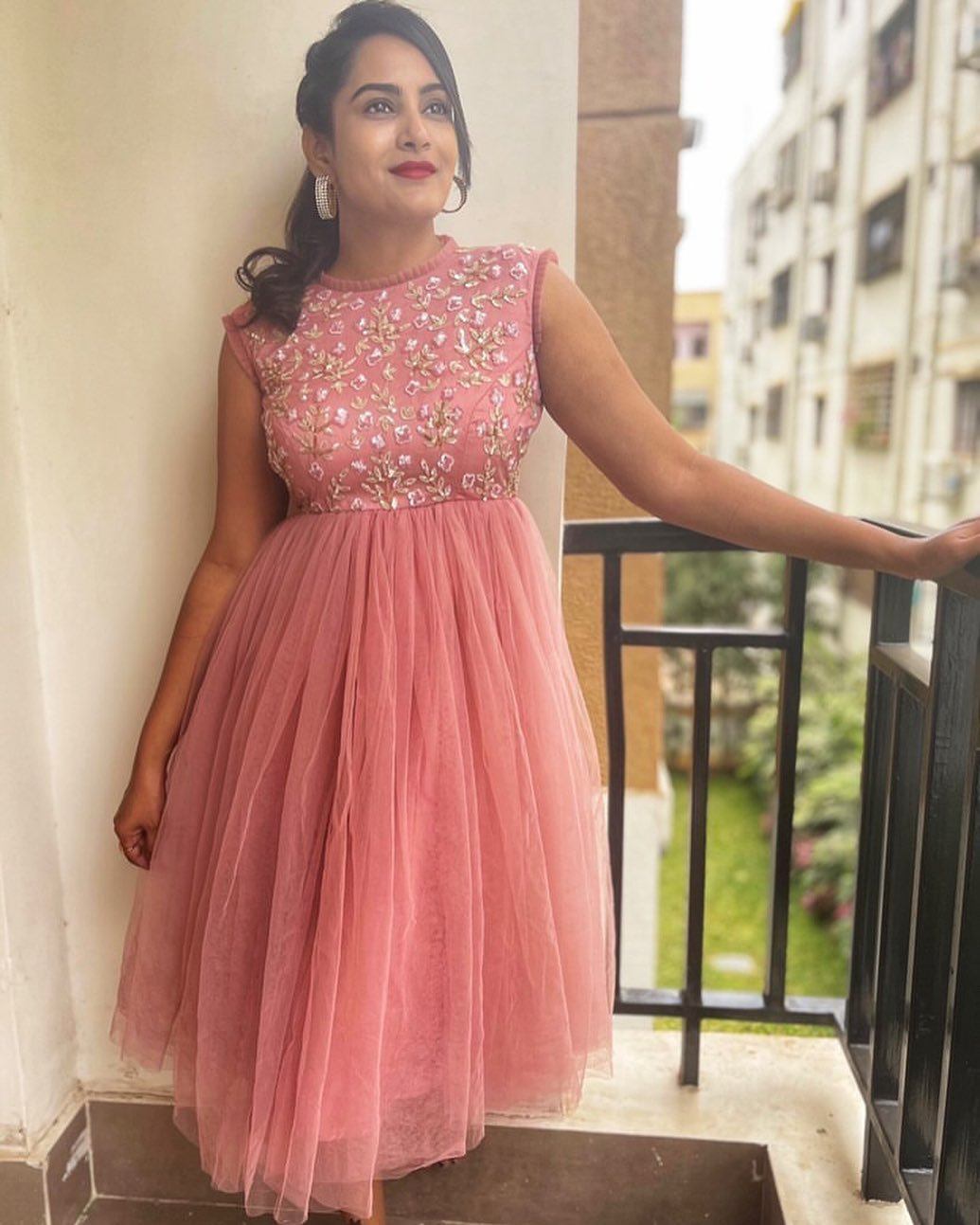Stunning actress Himaja in peach knee length dress. 2021-05-11