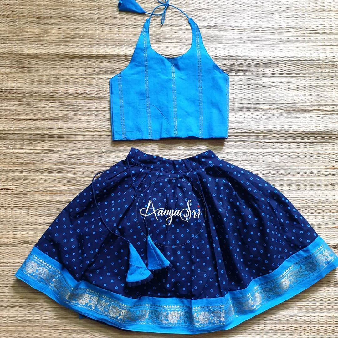 Bhandej and Zari Edit. Price : RS. 1500 – RS. 1700. Blue bhandej kids frock with zari border in halter neck style. Can be customized as a normal frock too. 2021-05-11