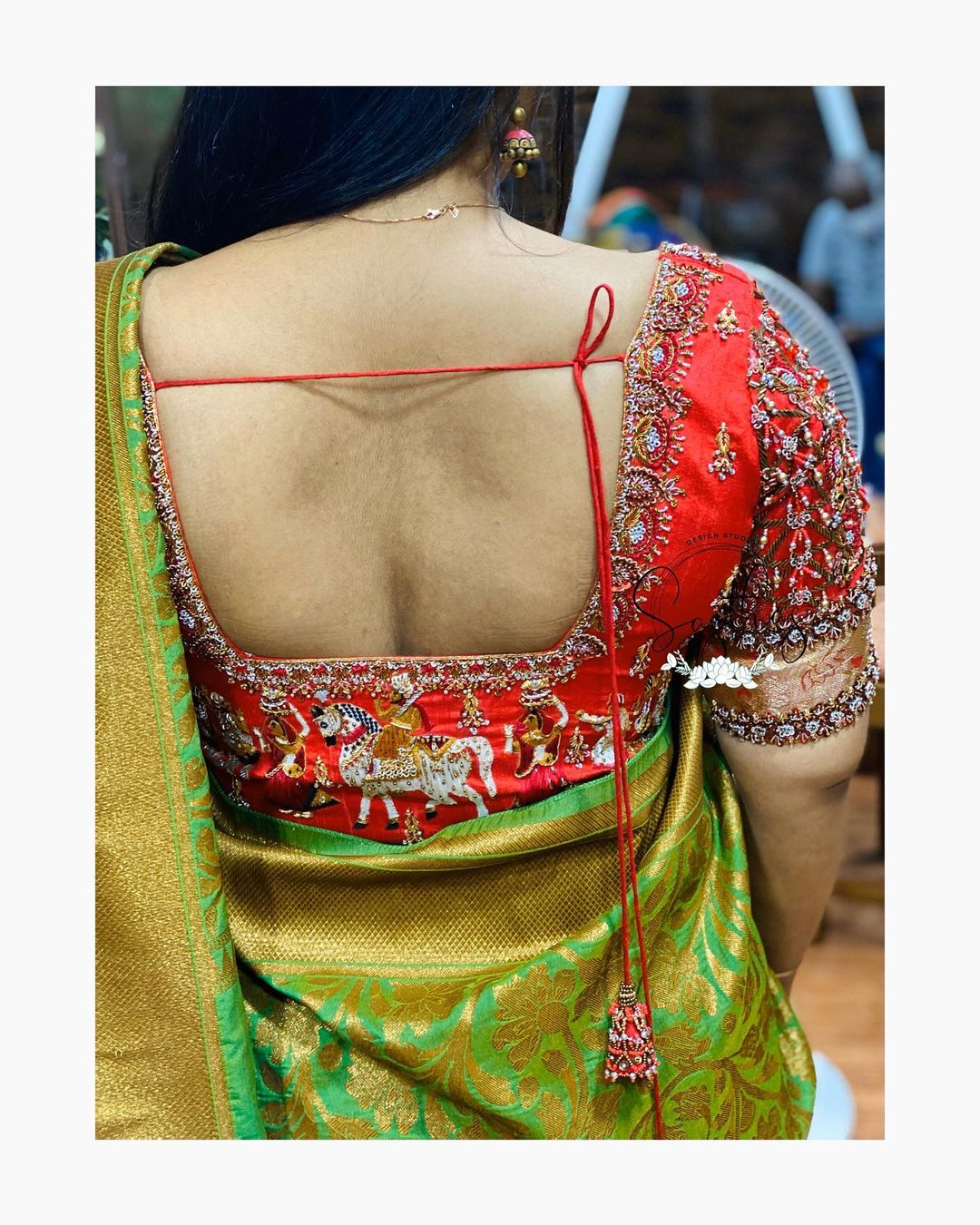 Stunning red color bridal blouse design with bead and stone aari work on back. 2021-05-11