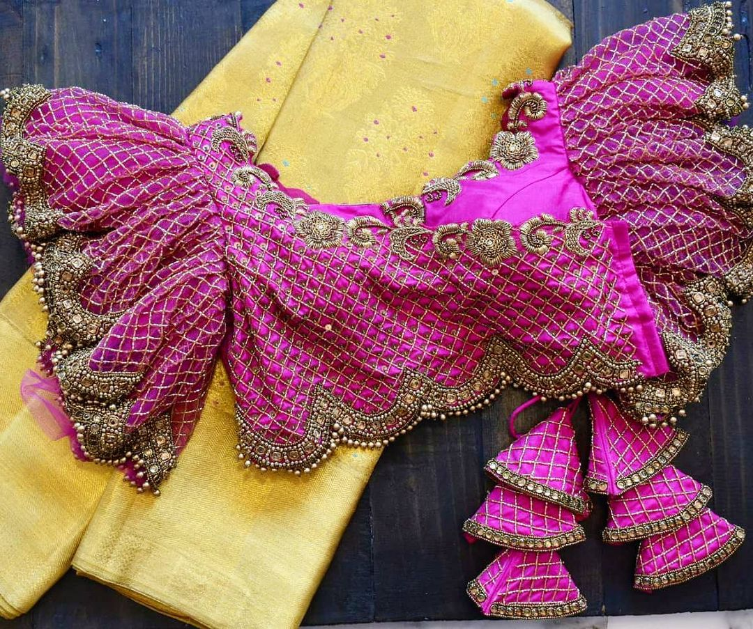 Stunning pink color bell sleeve blouse with hand embroidery work.  2021-05-11