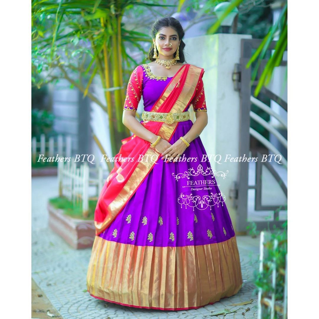 Stunning purple and red color combination traditional pattu langa voni. Blouse with hand embroidery work.  2021-05-11