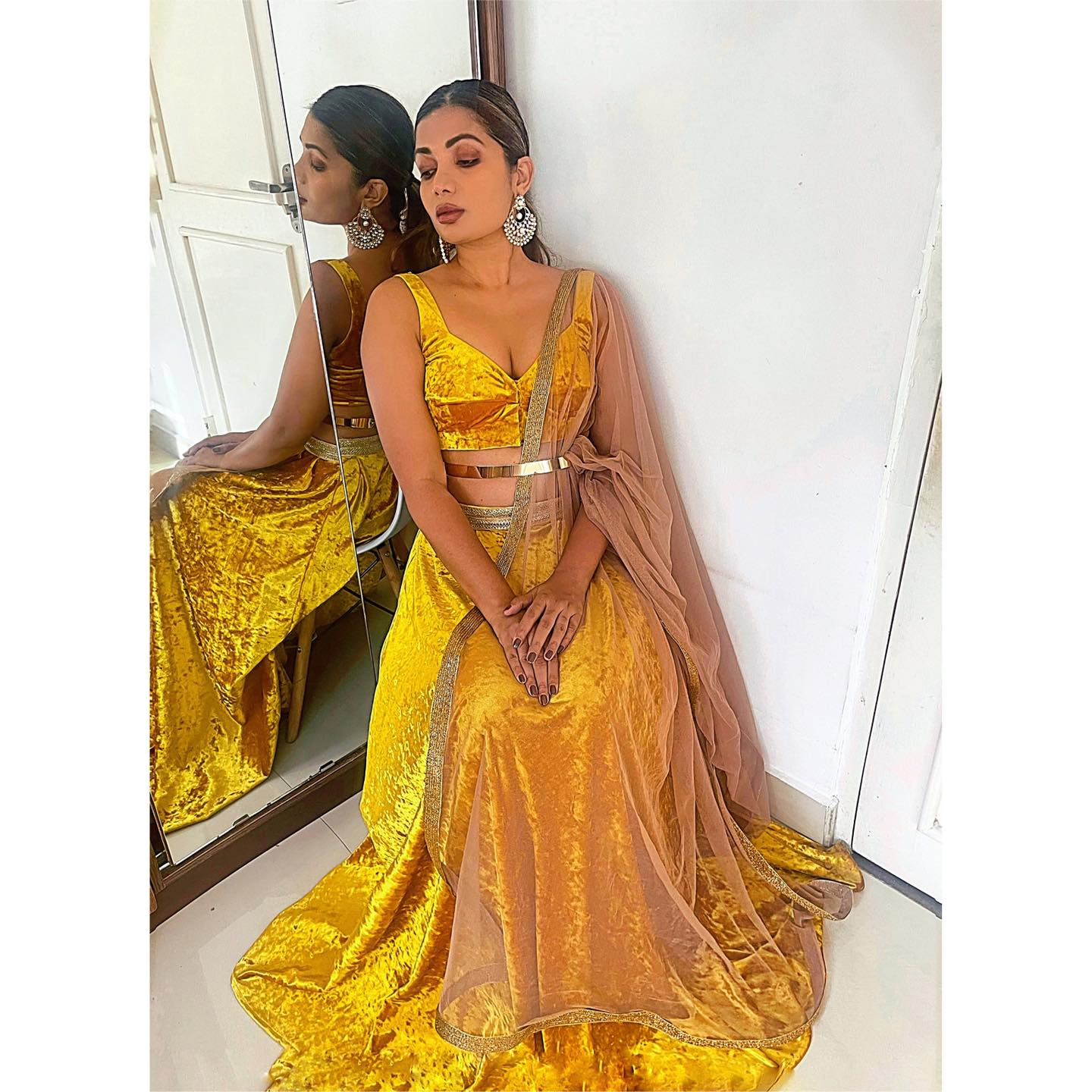 New design .  MUSTARD MELT.  Full velvet lehenga in mustard gold. It's a beautiful soft velvet lehenga and blouse with gold accents. The dupatta is a taupe beige soft net with a gold border. 2021-05-12