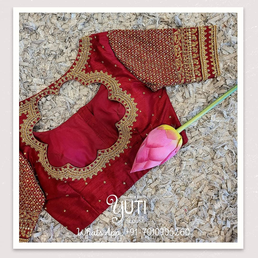 Stunning red color bridal blouse design with bead and stone aari work. 2021-05-12