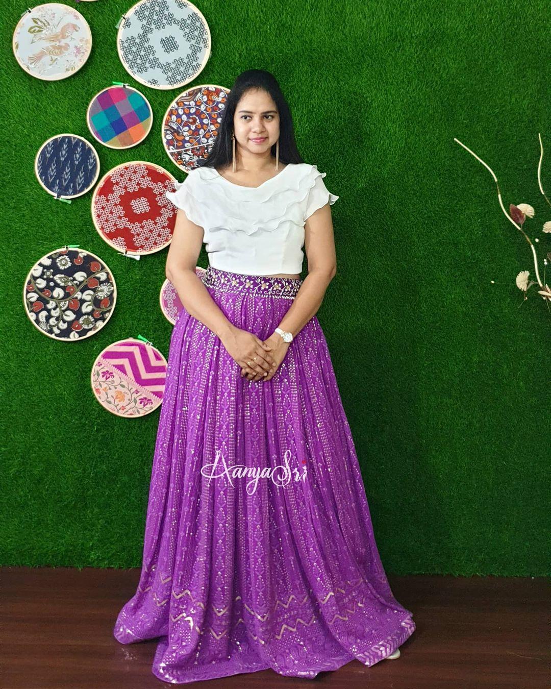 Purple Chickankari.  Price : RS. 6300/- Purple chickankari skirt with handworked waistline paired with white three layered ruffles crop top . 2021-05-12
