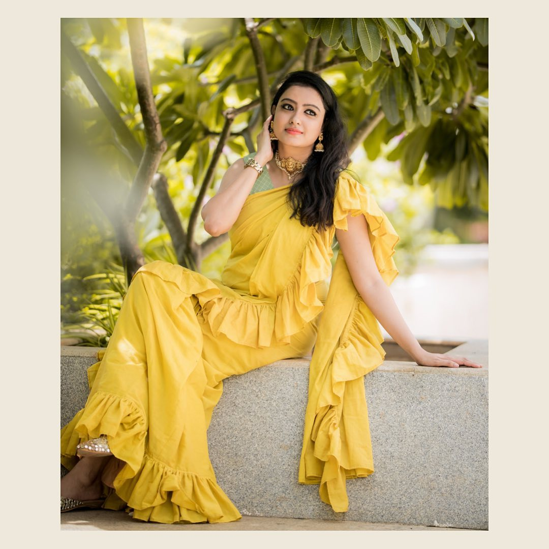 Beautiful lime yellow color ruffle saree with sleeveless blouse.  2021-05-13