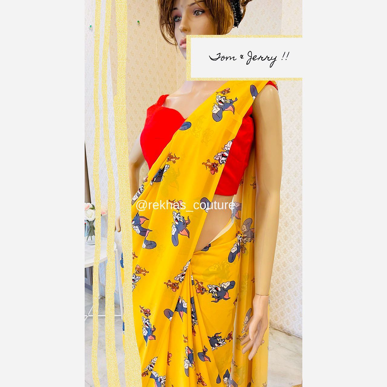 Stunning yellow color Tom and Jerry print saree with red sleeveless blouse. 2021-05-13
