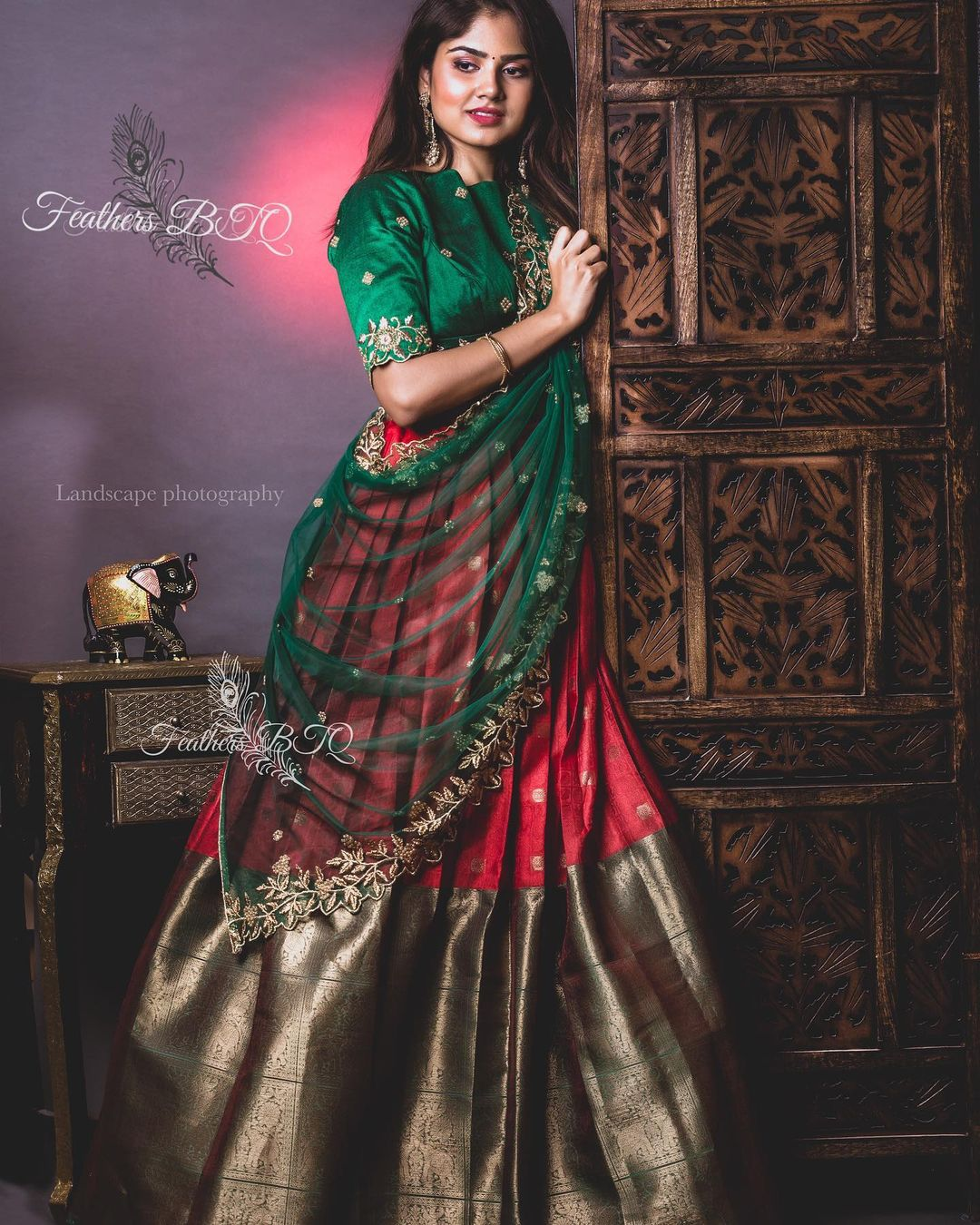 Stunning red and bottle green color combination pattu lehenga and high neck blouse with net dupatta. 2021-05-14