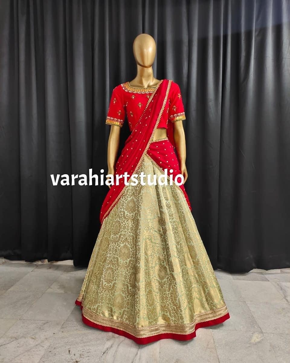 Stunning gold shade pattu lehenga and red blouse with net dupatta.  2021-05-14