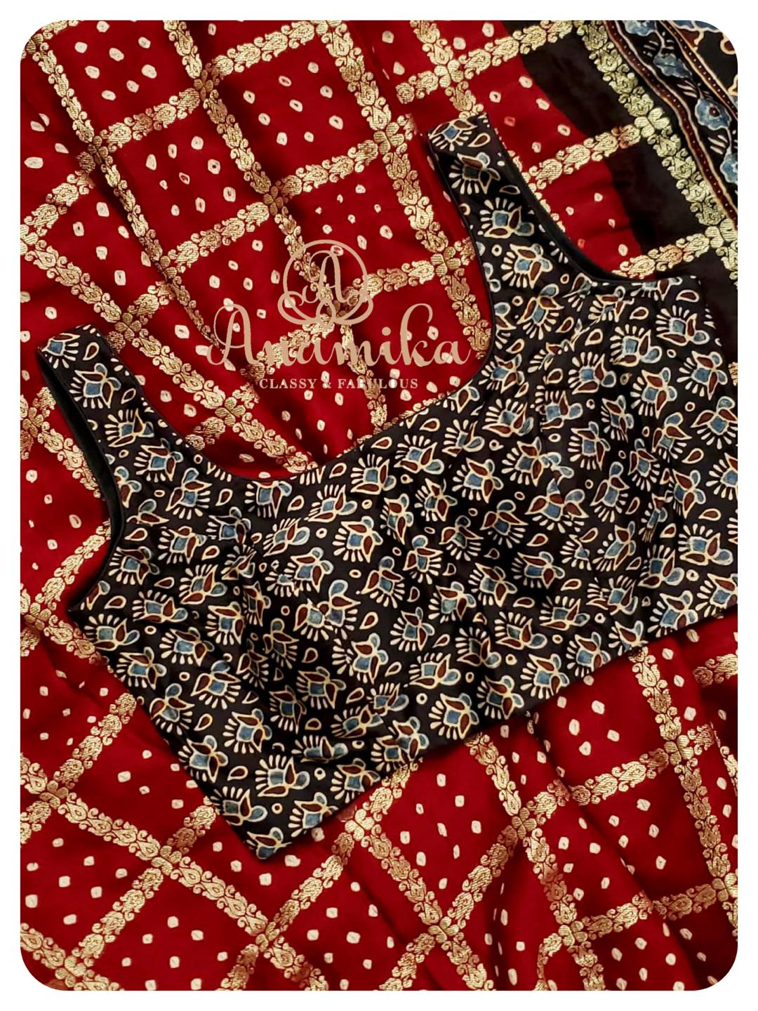 Yet another Bandini Gharchola saree in maroon shade with ajrak printed pallu. Blouse complements the pallu perfectly to create that WOW look.  Sleeves available and can be attached per request.  DM 360-545-3636 for inquiries 2021-05-15