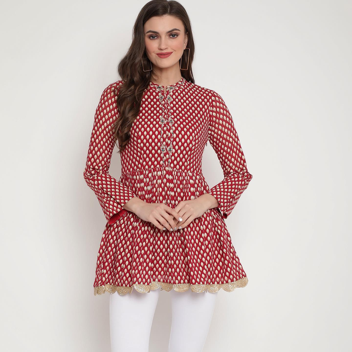 DEMURE . P R E T 2021. . Red bindu print peplum top with embroidered front and neckline.  2021-05-15
