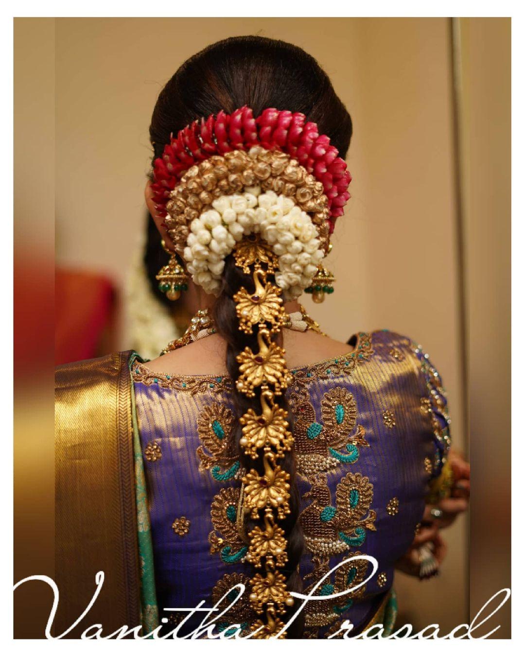 Stunning purple brocade blouse with swan design hand embroidery  aari work on back. 2021-05-15